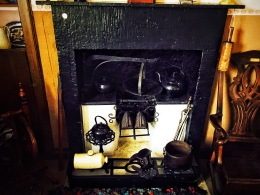 Fireplace with cooking utensils